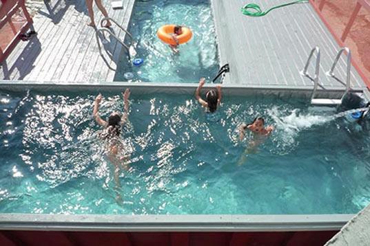 Dumpster pools garbage receptacles turned summer fun for Repurposed swimming pool