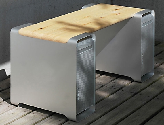 the main piece in benchmarc is a wooden bench that uses two power mac ...